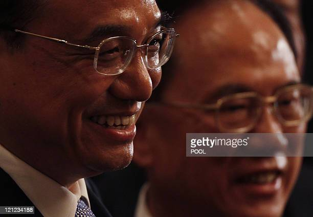 China's Vice Premier Li Keqiang and Hong Kong Chief Executive Donald Tsang meet business leaders in Hong Kong on August 16 2011 Li the expected...