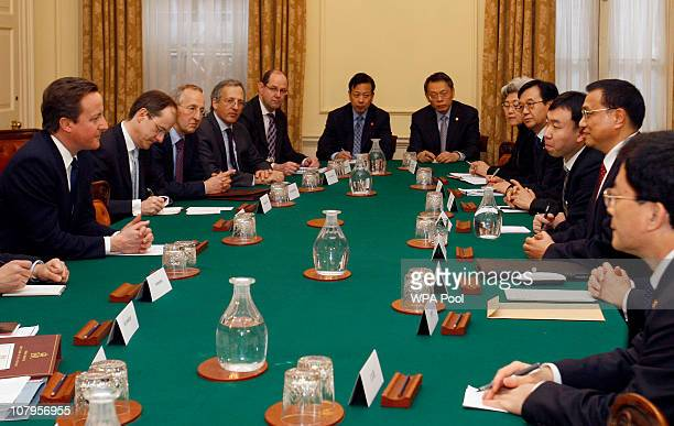 China's Vice Premier Li Keqiang attends a round table discussion with Britain's Prime Minister David Cameron at Downing Street on January 10 2011 in...
