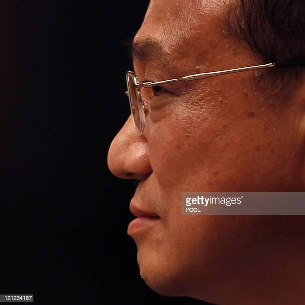 China's Vice Premier Li Keqiang looks on during a meeting with business leaders in Hong Kong on August 16 2011 Li the expected successor to Premier...