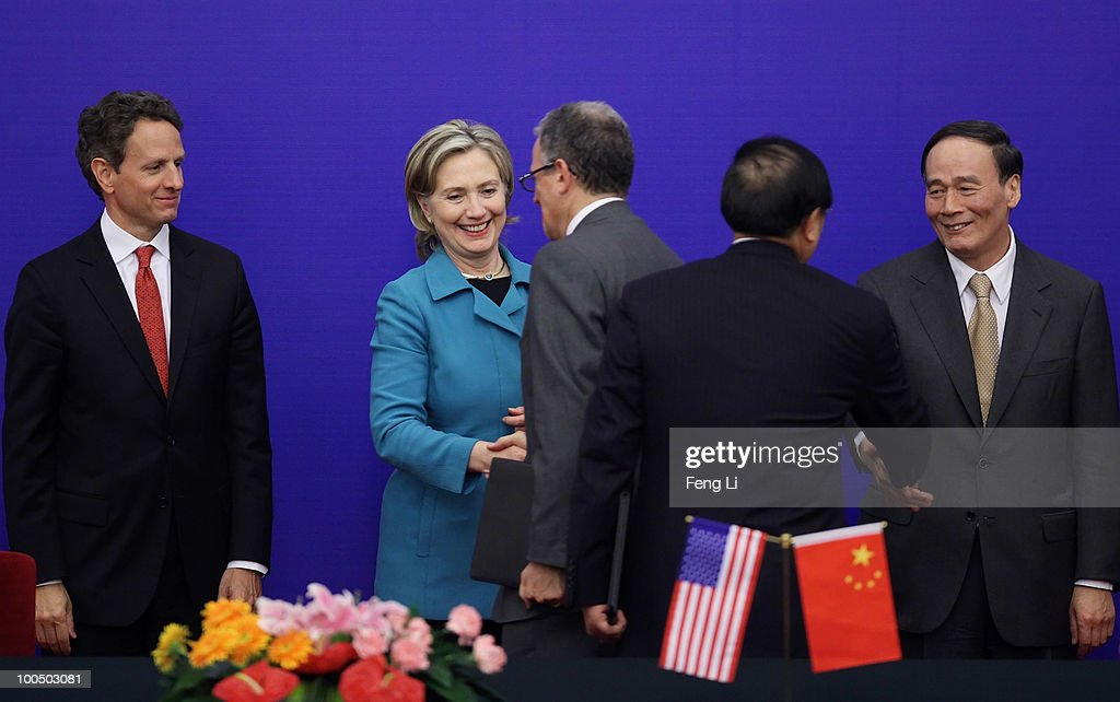 China's Vice Premier Wang Qishan (R) and U.S. Secretary of State Hillary Clinton (2nd L) shake hands with bilateral delegates as U.S. Treasury Secretary Timothy Geithner (L) stands by during a signing ceremony for the China-U.S. Strategic and Economic Dialogue (S&ED) at the Great Hall of People on May 25, 2010 in Beijing, China. Hillary Clinton called upon Beijing to back international pressure against North Korea following the sinking of a South Korean warship, and to seek greater stability in the region.