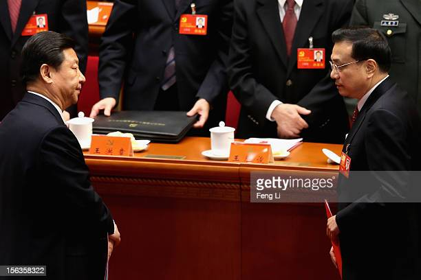 China's Vice President Xi Jinping and China's Vice-Premier Li Keqiang leave their seats after the closing session of the 18th National Congress of...