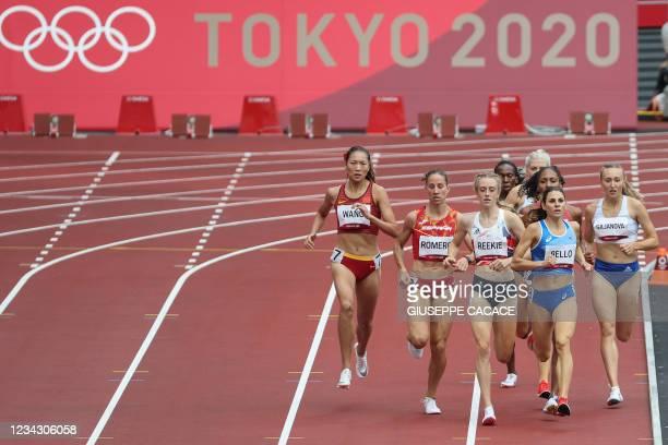 China's Wang Chunyu, Spain's Natalia Romero, Britain's Jemma Reekie, and Italy's Elena Bello compete in the women's 800m heats during the Tokyo 2020...