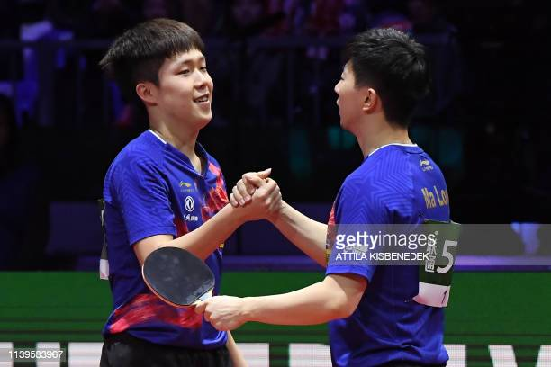 China's Wang Chuqin and China's Ma Long celebrate winning the men's doubles final at the ITTF World Table Tennis Championships 2019 in Budapest on...