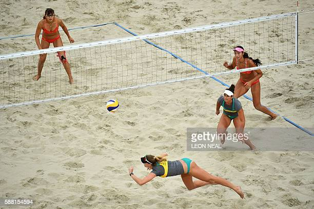 China's Wang Fan and China's Yue Yuan vie with Australia's Mariafe Artacho Del Solar and Australia's Nicole Laird during the women's beach volleyball...