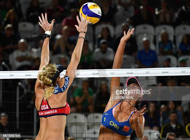 China's Wang Fan jumps to spike the ball during the women's beach volleyball qualifying match between the USA and China at the Beach Volley Arena in...