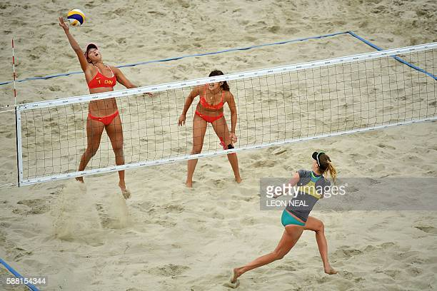 China's Wang Fan vies with Australia's Nicole Laird during the women's beach volleyball qualifying match between China and Australia at the Beach...