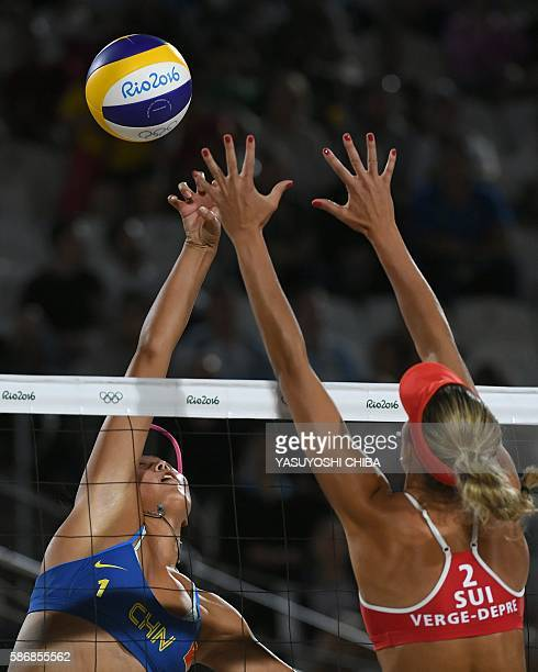 China's Wang Fan vies with Switzerland's Anouk VergeDepre during the women's beach volleyball qualifying match between Switzerland and China at the...