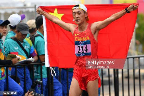 China's Wang Kaihua celebrates winning the men's 20km walk race competition during the 2018 Asian Games in Jakarta on August 29 2018