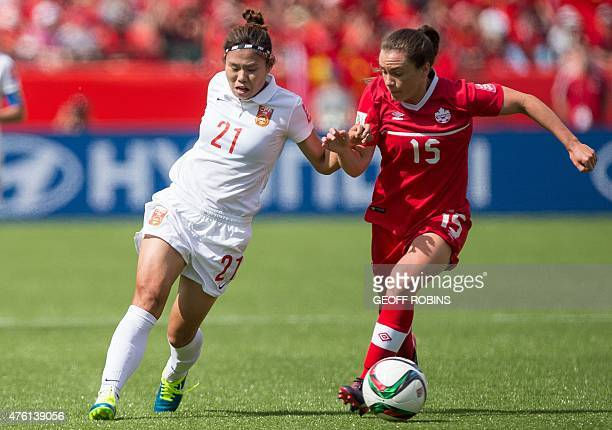 China's Wang Lisi vies with Canada's Allysha Chapman during a Group A football match between China and Canada at Commonwealth Stadium during the...