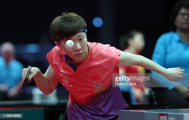 TOPSHOT China's Wang Manyu returns the ball to Romania's Elizabeta Samara on April 24 2019 during their women's single match at the ITTF World Table...