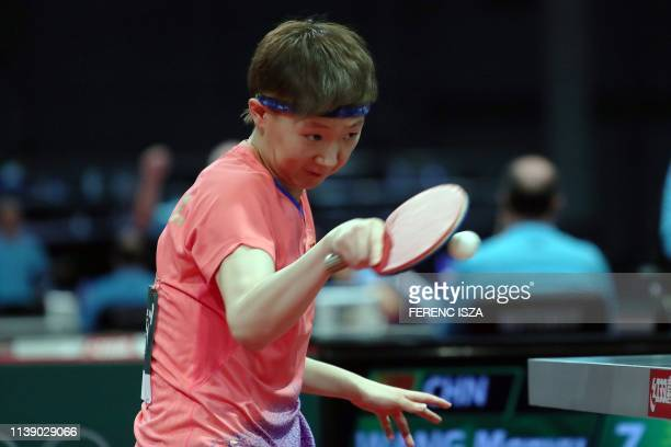 China's Wang Manyu returns the ball to Romania's Elizabeta Samara on April 24 2019 during their women's single match at the ITTF World Table Tennis...