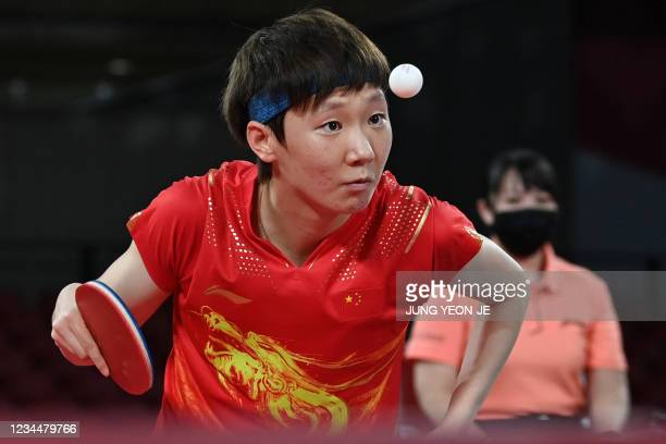 China's Wang Manyu serves the ball during their women's team final table tennis match at the Tokyo Metropolitan Gymnasium during the Tokyo 2020...
