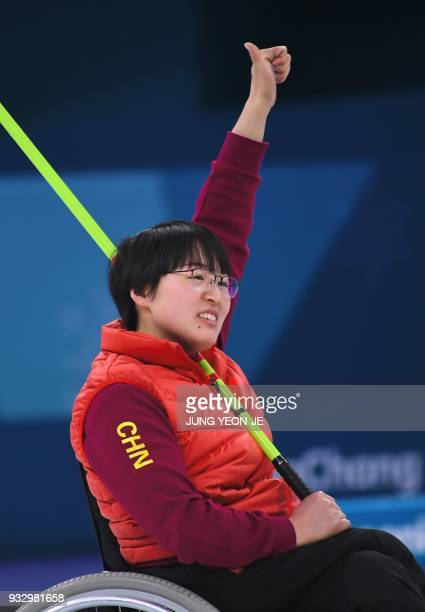 China's Wang Meng gestures after throwing a stone in the Wheelchair Curling gold medal game between China and Norway at the Gangneung Curling Centre...