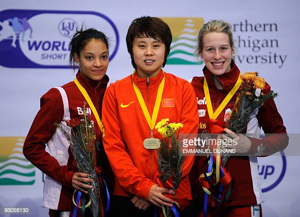 China's Wang Meng with gold Canada's Kalyna Roberge with silver and Canada's Marianne StGelais celebrate on the winners' podium of the women's 500m...