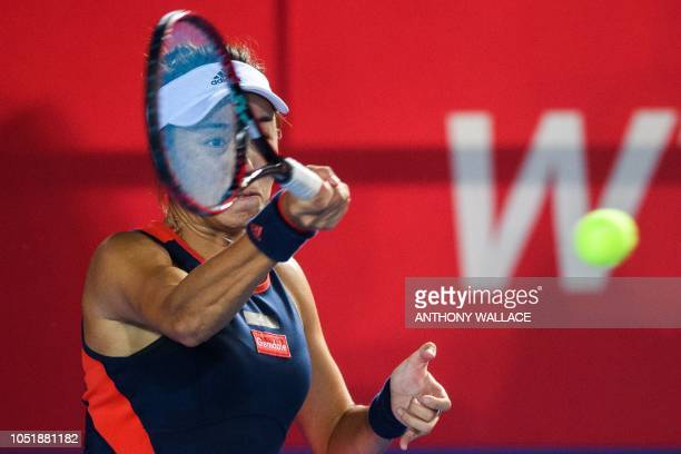 China's Wang Qiang hits a return during her women's singles second round match against Christina McHale of the US at the Hong Kong Open tennis...