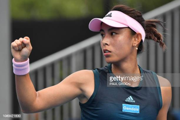 China's Wang Qiang reacts after a point against Serbia's Aleksandra Krunic during their women's singles match on day four of the Australian Open...