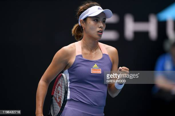 China's Wang Qiang reacts after a point against Tunisia's Ons Jabeur during their women's singles match on day seven of the Australian Open tennis...