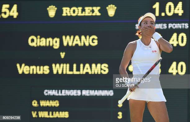 China's Wang Qiang reacts after a point against US player Venus Williams during their women's singles second round match on the third day of the 2017...