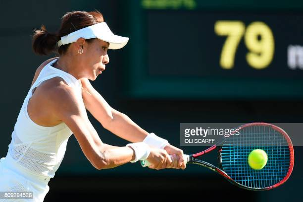 China's Wang Qiang returns against US player Venus Williams during their women's singles second round match on the third day of the 2017 Wimbledon...
