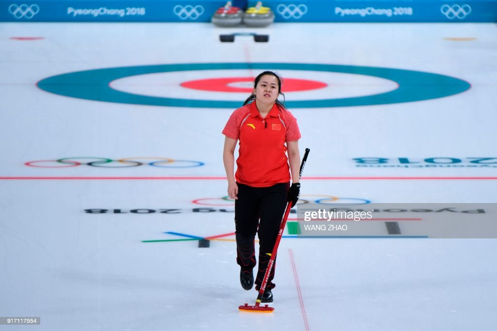 China's Wang Rui reacts during the curling mixed doubles tie-breaker game during the Pyeongchang 2018 Winter Olympic Games at the Gangneung Curling Centre in Gangneung on February 11, 2018. / AFP PHOTO / WANG Zhao