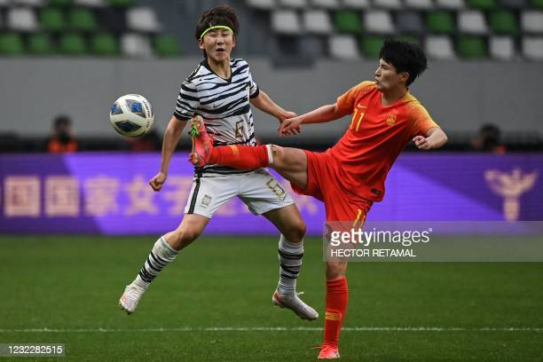 China's Wang Shanshan and South Korea's Lim Seon-joo compete for the ball during the qualifying play-off second leg women's football match for the...