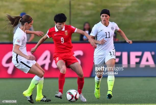 China's Wang Shanshan vies for the ball with Ali Krieger and Morgan Brian of the US during a 2015 FIFA Women's World Cup quarterfinal match at...