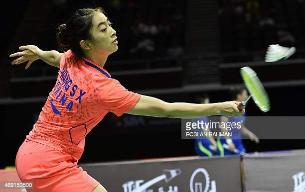 China's Wang Shixian plays against Japan's Akane Yamaguchi in their women's single quarterfinals of the Singapore Open on April 10 2015 AFP PHOTO /...