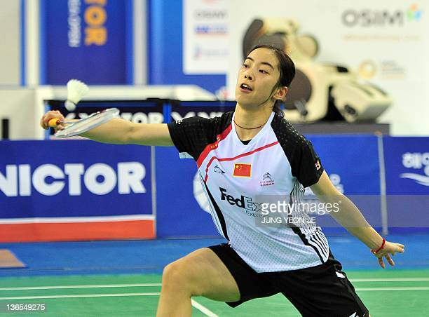 China's Wang Shixian returns a shuttlecock against compatriot Jiang Yanjiao in the women's singles final match at the Korea Open Badminton Super...