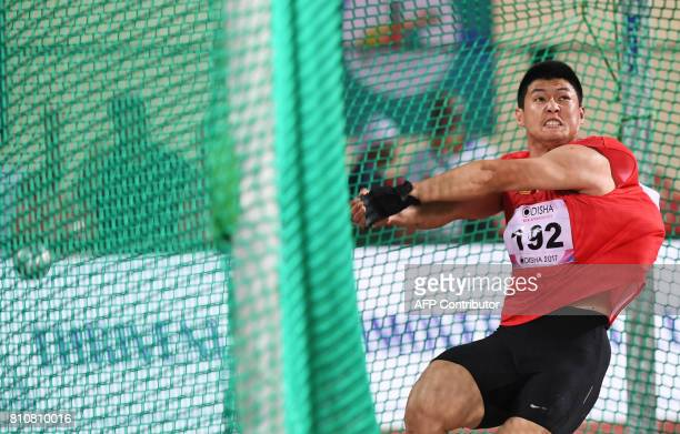China's Wang Shizhu competes in the men's hammer throw event to win Silver Medal, during the third day of the 22nd Asian Athletics Championships at...