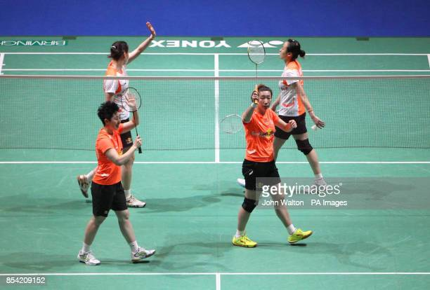 China's Wang Xiaoli and teammate Yu Yang celebrate winning the final of the women's doubles during day Six of the 2013 Yonex All England Badminton...