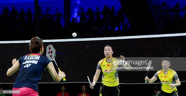 China's Wang Xiaoli and Yu Yang compete against Japan's Reika Kakiiwa and Miyuki Maeda during the women's double semi final match at the 2014 BWF...