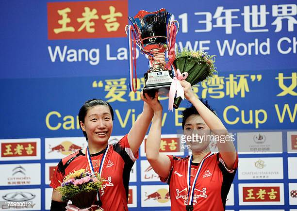 China's Wang Xiaoli and Yu Yang pose with their trophy after winning their women's doubles final against South Korea's Eom Hye Won and Jang Ye Na at...