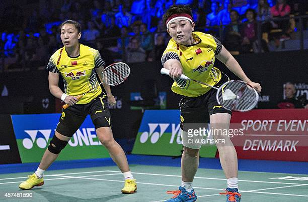 China's Wang Xiaoli and Yu Yang return to Japan's Misaki Matsutomo and Ayaka Takahashi during their women's double final match of the Denmark Open...