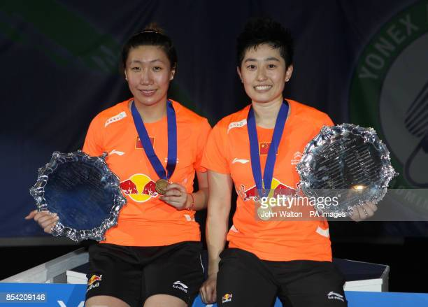 China's Wang Xiaoli celebrates with teammate Yu Yang after their victory in the final of the women's doubles during day Six of the 2013 Yonex All...