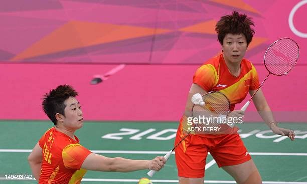 China's Wang Xiaoli plays a shot as Yu Yang looks on during their women's double badminton match against Valeria Sorokina and Nina Vislova of Russia...