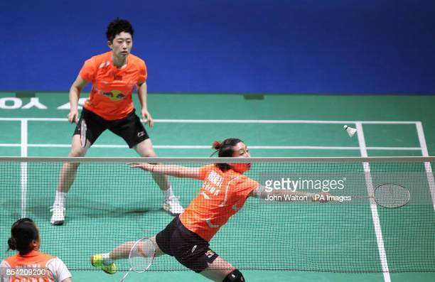 China's Wang Xiaoli stretches to return watched by teammate Yu Yang as they go on to win the final of the women's doubles during day Six of the 2013...