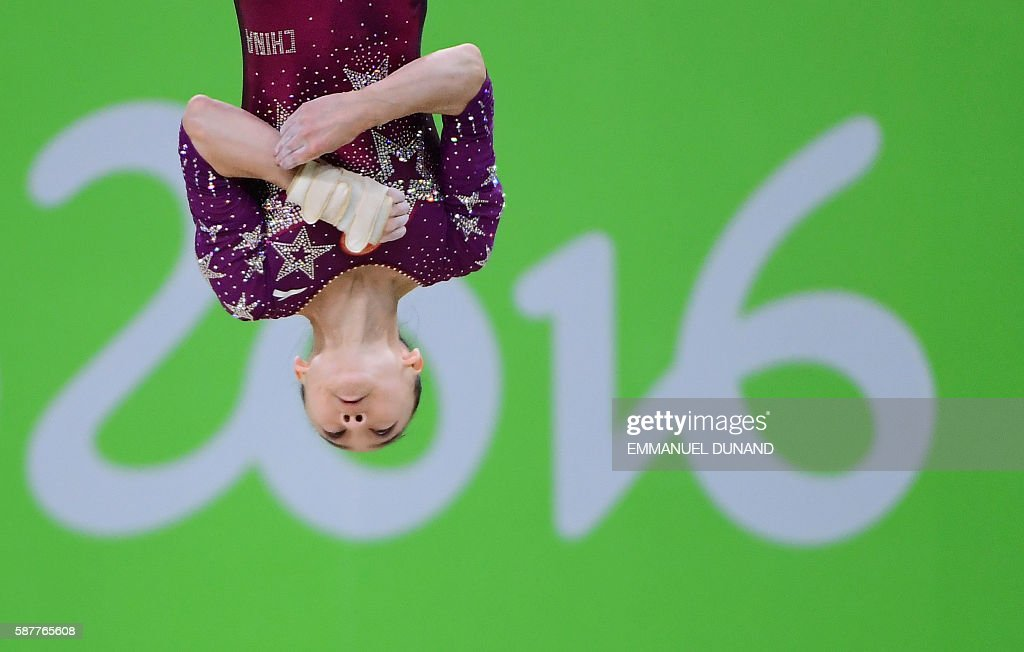 TOPSHOT - China's Wang Yan competes in the Floor event during the women's team final Artistic Gymnastics at the Olympic Arena during the Rio 2016 Olympic Games in Rio de Janeiro on August 9, 2016. / AFP / Emmanuel DUNAND