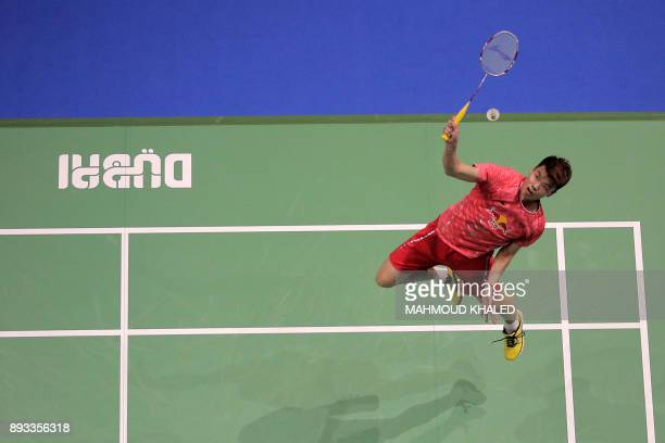 TOPSHOT China's Wang Yilyu returns a shot with his partner Huang Dongping to Indonesia's Ahmad Tantowi and Lilyana Natsir during their mixed doubles...