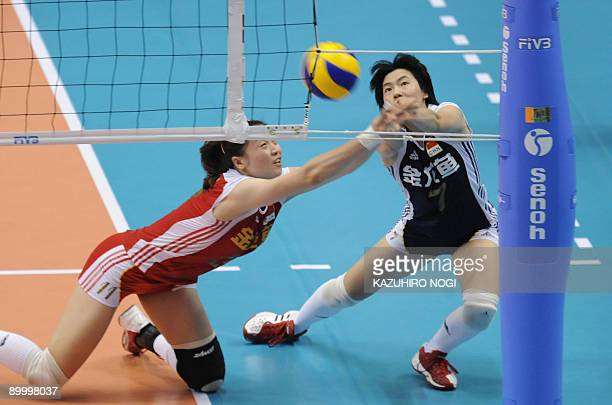 China's wei Qiuyue and Zhang Xian try to return the ball against Japapn during their final round match of the World Grand Prix women's volleyball...