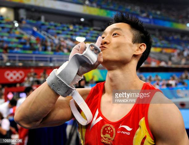 China's Wei Yang gestures after the men's individual all-around final of the artistic gymnastics event of the Beijing 2008 Olympic Games in Beijing...