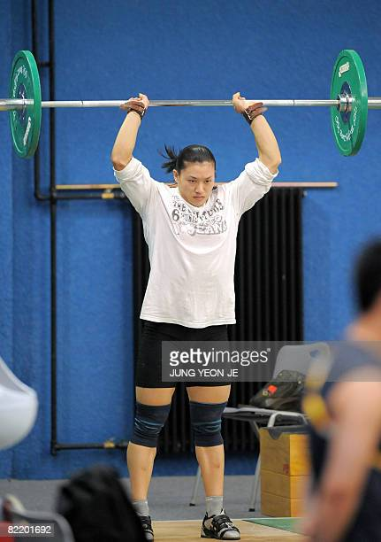 China's weightlifter Cao Lei practices in a training hall of the Beijing University of Aeronautics and Astronautics Gymnasium in Beijing on August 7...