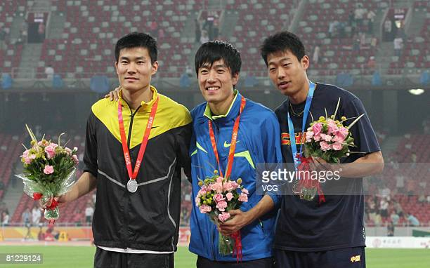 China's world and Olympic champion Liu Xiang with the gold medal, Shi Dongpeng with the silver medal and Ji Wei with the bronze medal for the Men's...