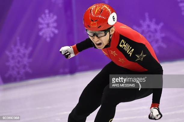 TOPSHOT China's Wu Dajing celebrates winning the gold medal in the men's 500m short track speed skating A final event during the Pyeongchang 2018...