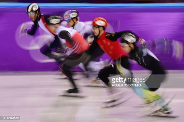 China's Wu Dajing competes in the men's 500m short track speed skating heat event during the Pyeongchang 2018 Winter Olympic Games, at the Gangneung...