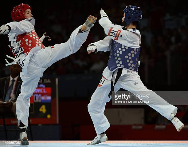 China's Wu Jingyu fights against Croatia's Ana Zaninovic during their women's taekwondo semifinal bout in the category under 49 kg as part of the...