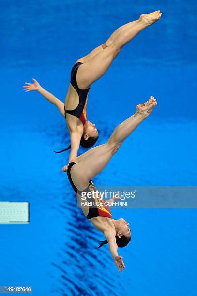 China's Wu Minxia and He Zi dive during the women's synchronised 3m springboard diving event at the London 2012 Olympic Games on July 29, 2012 in...