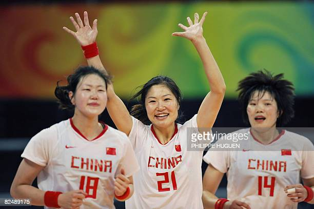 China's Wu Wenjuan Li Bing and Liu Xiaomei celebrate after defeating Sweden in a women's placement 58 handball match of the 2008 Beijing Olympic...