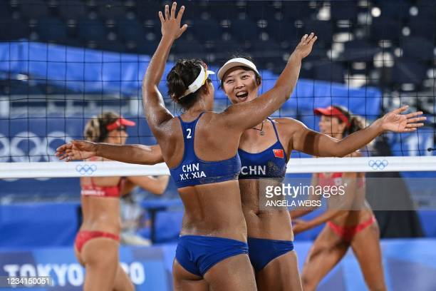 China's Xia Xinyi hugs partner Wang Fan in their women's preliminary beach volleyball pool C match between Canada and China during the Tokyo 2020...