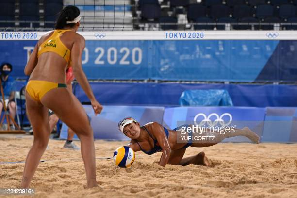 China's Xia Xinyi reaches for the ball in their women's preliminary beach volleyball pool C match between Brazil and China during the Tokyo 2020...
