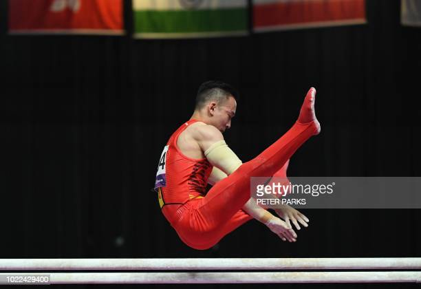 China's Xiao Ruoteng compete on the parallel bars competition in the final at the artistic gymnastics event during the 2018 Asian Games in Jakarta on...